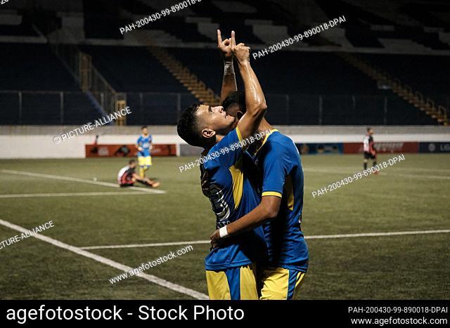 29 April 2020, Nicaragua, Managua: Managua FC's Nahum Peralta (l) celebrates with a teammate a goal in the second leg of the semi-final between Walter Ferreti...