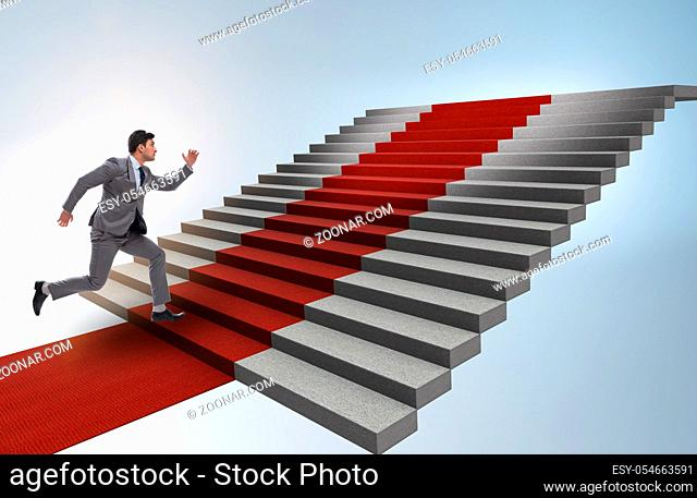 The young businessman climbing stairs and red carpet