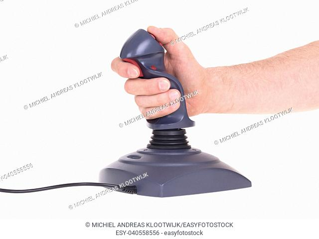 Hand holding gaming joystick, isolated on a white background