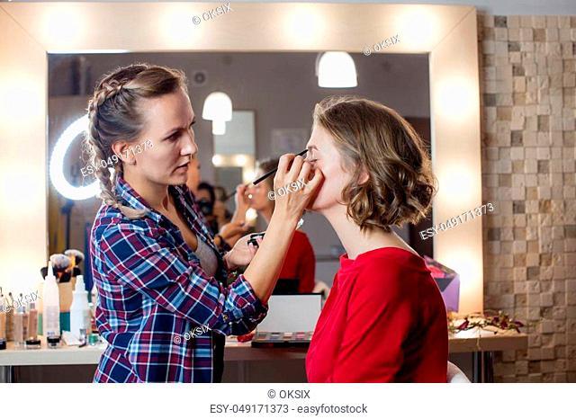 Make up artist creates a beautiful makeup for model