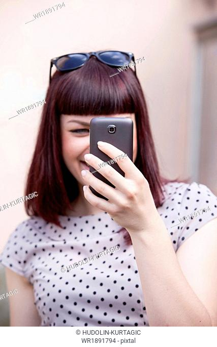 Young woman using smart phone, Osijek, Croatia
