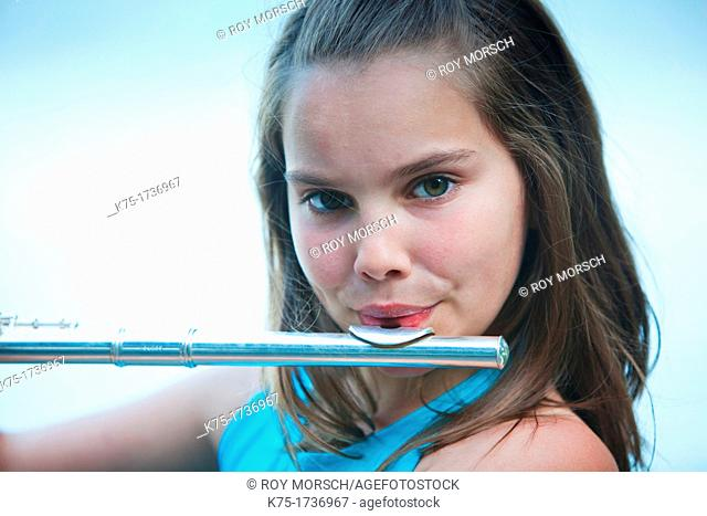 young girl playing flute