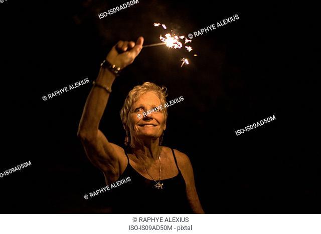 Portrait of woman holding sparkler on independence day, Destin, Florida, USA
