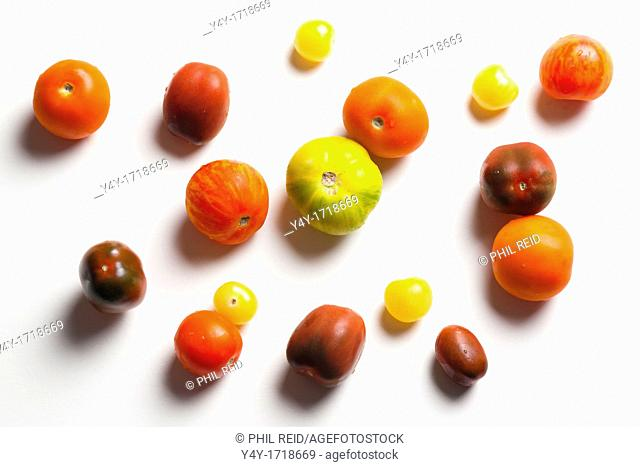 Group of heirloom tomatoes on white background