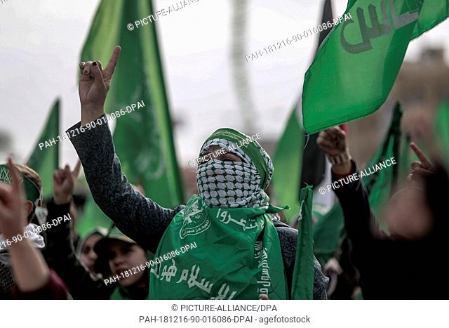 16 December 2018, Palestinian Territories, Gaza City: A Palestinians woman gestures as she takes part in a rally marking the 31st anniversary of the founding of...