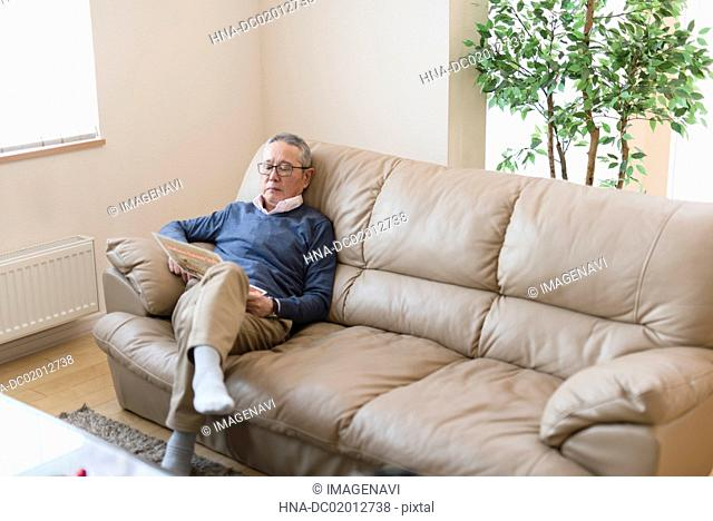 Senior man relaxing on sofa