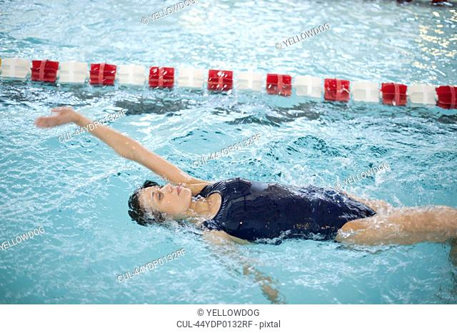 Woman doing laps in swimming pool