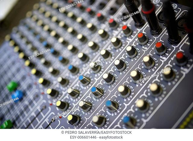 Management handles close up of mixer panel