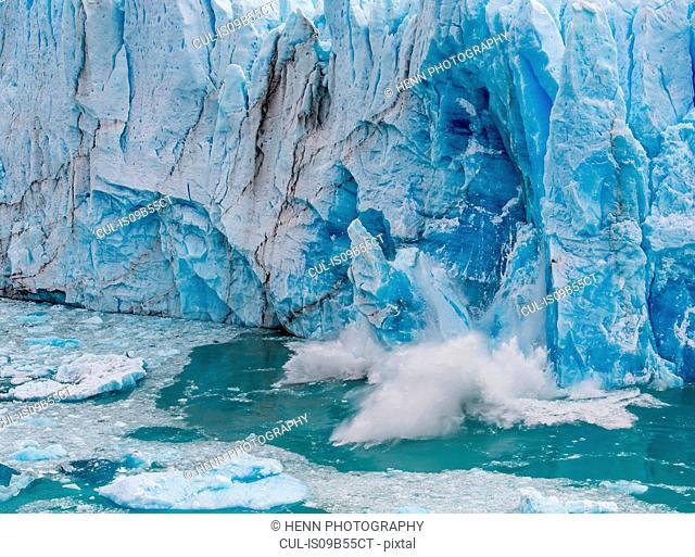 Chunk of ice falling from Perito Moreno Glacier, Los Glaciares National Park, Southwest Santa Cruz Province, Argentina