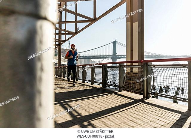USA, New York City, man running at East River
