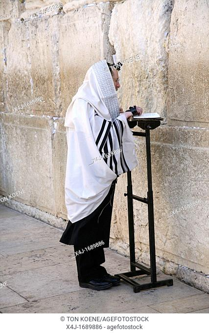 A man prays at the Western wailing wall in Jerusalem