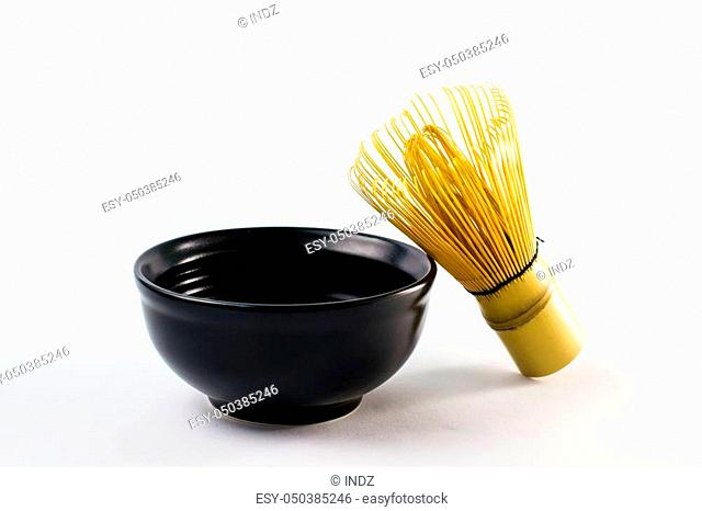 Bamboo whisk in black bowl on white background for decoration. Traditional of Japanese culture