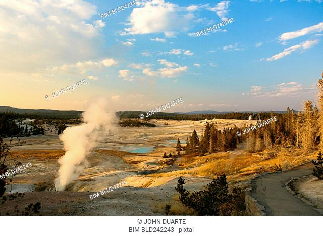 Steam rising from geyser in Yellowstone National Park, Wyoming, United States