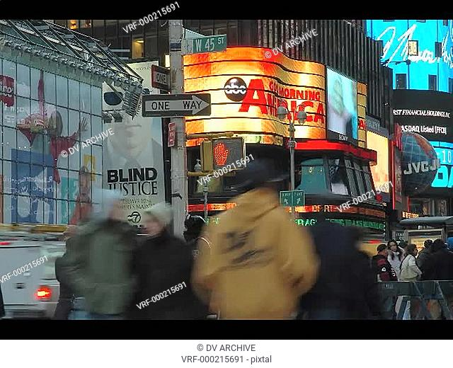 An accelerated shot of people and traffic moving through Times Square in New York City