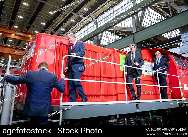 17 September 2020, Brandenburg, Cottbus: Michael Kretschmer (CDU, l-r), Prime Minister of Saxony, Olaf Scholz (SPD), Vice-Chancellor and Federal Minister of...