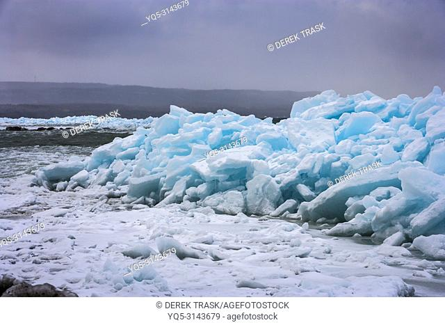 Blue Ice, Meaford, Georgian Bay, Ontario, Canada, Blue Ice occurs when snow falls, is compressed, air bubbles are squeezed out and ice crystals enlarge making...