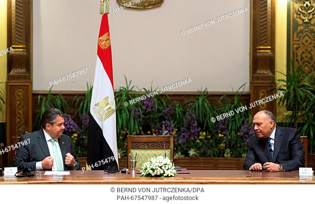 German economy minister Sigmar Gabriel (L)talks to Egypt's foreign minister Sameh Shoukry prior to a meeting with German business delegates in the presidential...