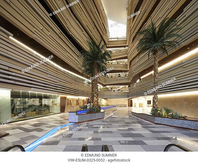 Overall atrium view early dusk. National Bank of Oman HQ, Muscat, Oman. Architect: LOM Architecture and Design, 2017