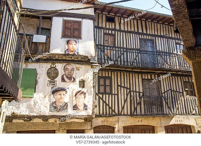 Facade of house and portraits of its owners. Mogarraz, Sierra de Francia Nature Reserve, Salamanca province, Castilla Leon, Spain