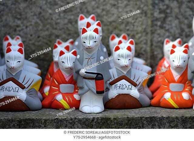 Small god fox figurine in Fushimi Inari Taisha,a large Shinto shrine complex near Kyoto, Japan,Asia