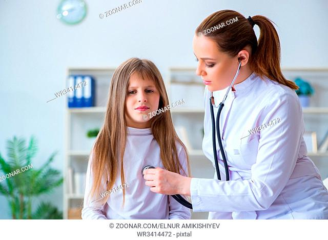 Female doctor pediatrician checking girl