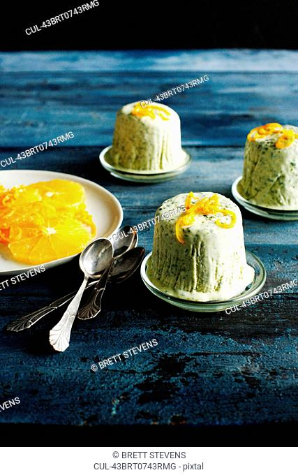 Plates of herb ice cream with orange