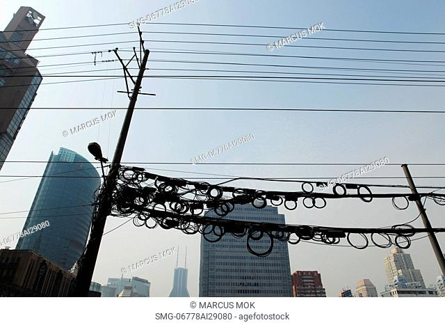 Coiled electrical wires above the street. Shanghai, China