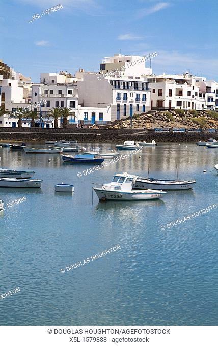 El Charco de San Gines ARRECIFE LANZAROTE Boats at anchor promenade and residential houses