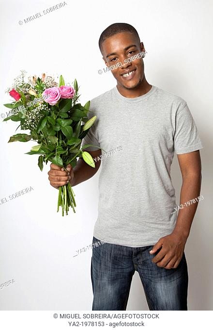 Guy Holding Bunch of Flowers