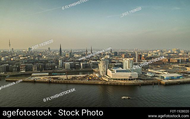 Sunny Hamburg cityscape along Elbe River, Germany