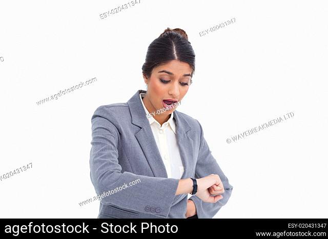 Shocked female entrepreneur looking at her watch