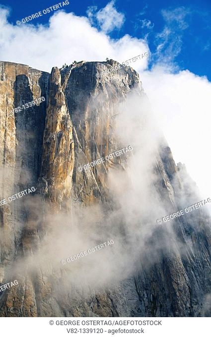 Cliff in clouds from Yosemite Falls Trail, Yosemite National Park, CA