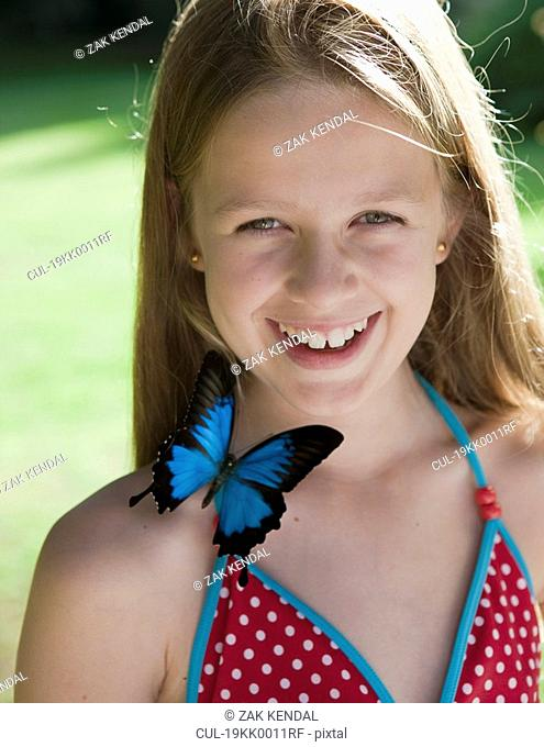 Portrait of girl with butterfly