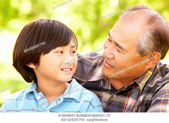 Boy and grandfather outdoors