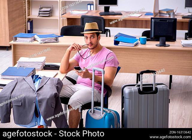 Young employee preparing for the trip
