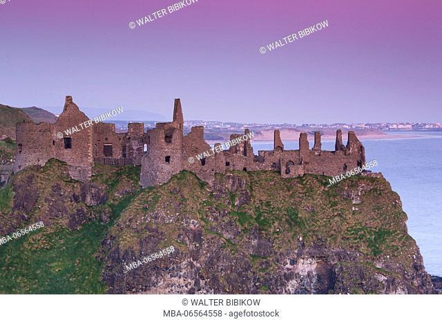 UK, Northern Ireland, County Antrim, Bushmills, Dunluce Castle ruins, dawn
