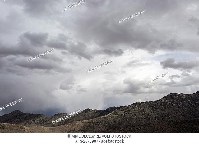 Storm clouds gather over a desert landscape in Southern California