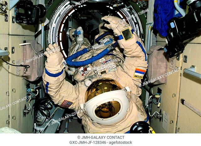 View of Russian Orlan space suits drifting in the Zarya module of the International Space Station (ISS). These Orlan spacesuits were used by Yury V