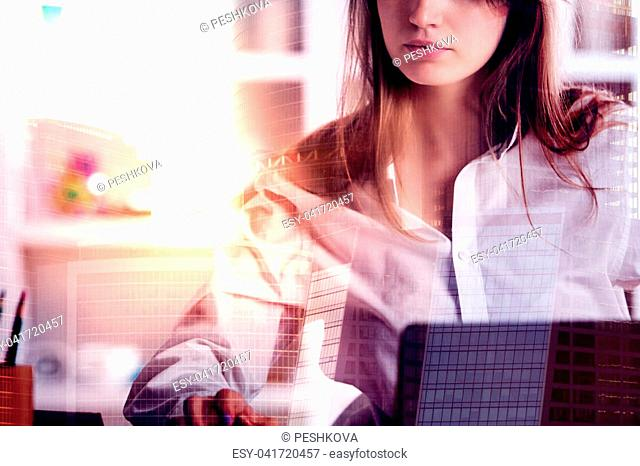 Portrait of attractive european woman working on abstract city background with sunlight. Double exposure