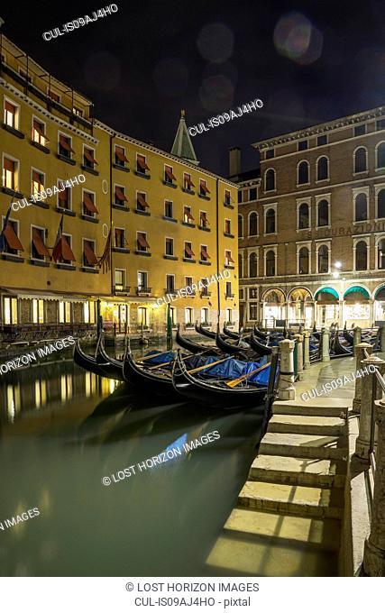 Canal steps and gondolas at night, Venice, Veneto, Italy