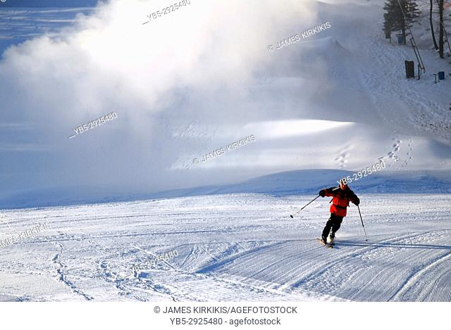 A skier enjoys the solitude of the first run of the day at Suicide Six Mountain near Woodstock, Vermont