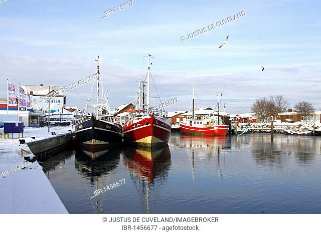 Fishing boats in the harbour of Heiligenhafen in winter on the Baltic Sea coast, Kreis Ostholstein district, Schleswig-Holstein, Germany, Europe
