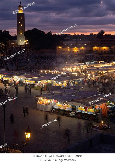 Crowded marketplace, Jemaa el Fnaa market and Koutoubia Mosque, Marrakesch, Morocco