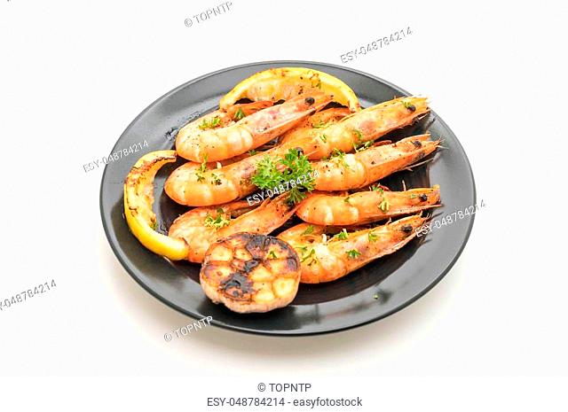fried shrimps with garlic and lemon isolated on white background