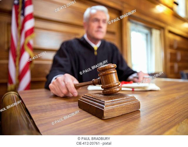 Judge holding gavel in court