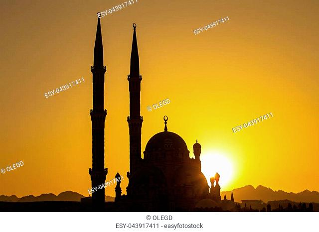 Silhouette Al-Sahaba Mosque at sunset time in Sharm el Sheikh, Egypt. Architecture of Al Sahaba, Al Mustafa, mosque in center of old town includes fusion of...