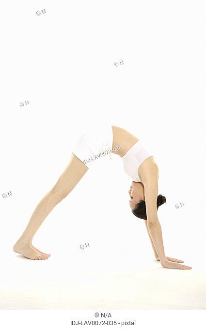 Woman doing yoga, downward dog position