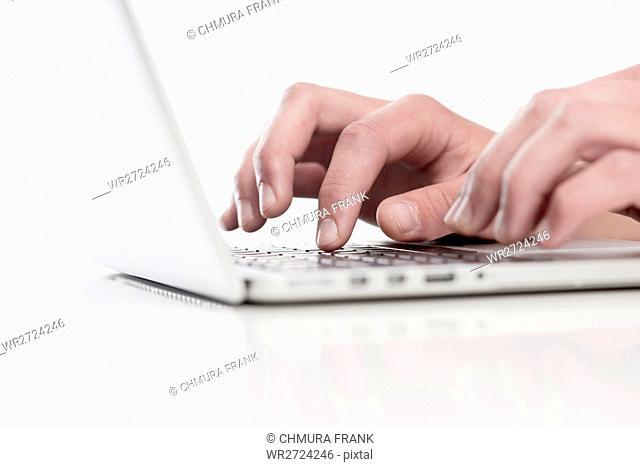 Closeup of Fingers Using Keyboard