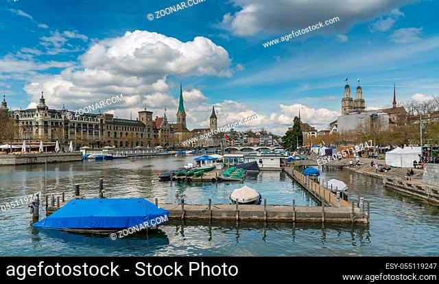 Zurich, ZH / Switzerland - April 8, 2019: Zurich cityscape with the river Limmat during the traditional spring festival of Sechselauten in April