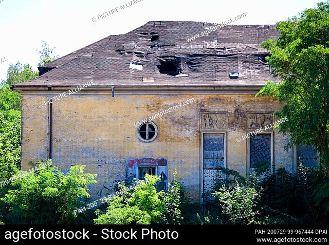 """14 July 2020, Brandenburg, Potsdam: Former buildings with a bookstore and the lettering """"""""Kniga"""""""" in Cyrillic letters on the former barracks grounds in..."""
